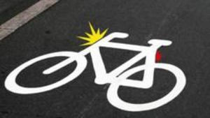 Thermoplast on the bicycle path is remembering you to turn on the lights